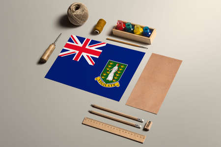 British Virgin Islands calligraphy concept, accessories and tools for beautiful handwriting, pencils, pens, ink, brush, craft paper and cardboard crafting on wooden table. 写真素材