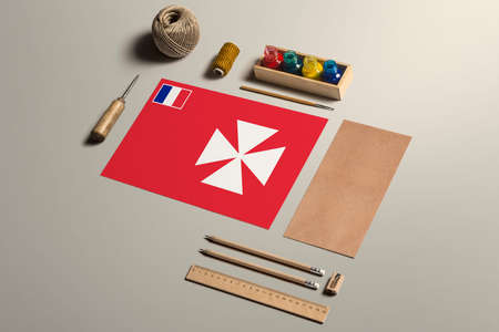 Wallis And Futuna calligraphy concept, accessories and tools for beautiful handwriting, pencils, pens, ink, brush, craft paper and cardboard crafting on wooden table.