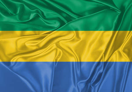 Gabon flag waving in the wind. National flag on satin cloth surface texture. Background for international concept.