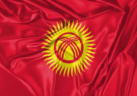 Kyrgyzstan flag waving in the wind. National flag on satin cloth surface texture. Background for international concept.