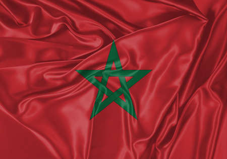 Morocco flag waving in the wind. National flag on satin cloth surface texture. Background for international concept. Archivio Fotografico