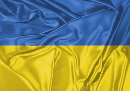 Ukraine flag waving in the wind. National flag on satin cloth surface texture. Background for international concept.