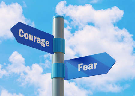 Street Sign the direction Way to Courage versus Fear. Banco de Imagens