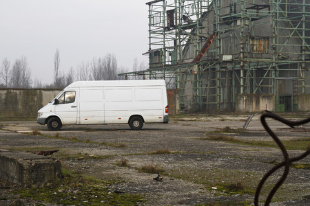 Suspicious white van moving in abandoned factory.