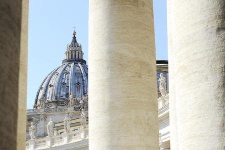 The Bernini's columns against saint peter's Basilica. Vatican city (Rome, Italy). Stock Photo