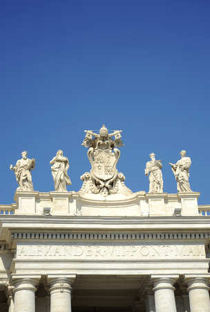 Detail from baroque Saint Peter's colonnade with beautiful statues of saints and Pope Alexander VII coat of arms. Vatican City (Rome, Italy)
