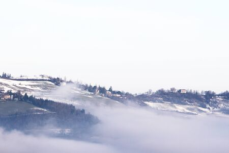 Winter landscape with snow and fog in the Tosco Emiliano Apennines, Bologna, Italy