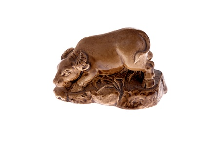 A small, brown, carved statue of an OX (one of the Chinese Zodiak animals). Also the western zodiak system for Taurus. Stock Photo