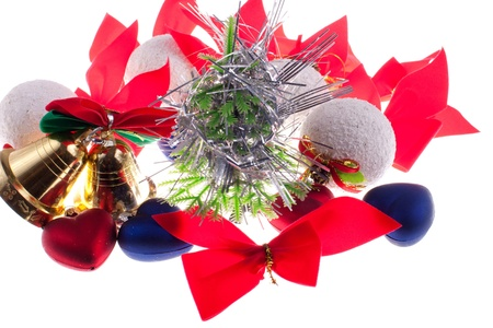 Christmas baubles and other decorations on a white background photo