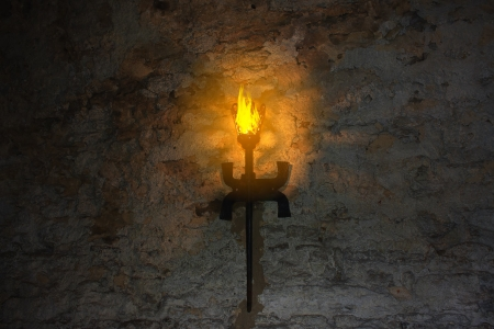 flametongue: torch on the wall of an old castle  Dubno, Ukraine Stock Photo