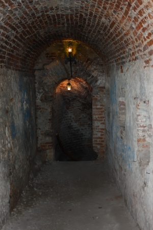 palaeolithic: Well lit catacombs of the castle in Dubno, Ukraine Stock Photo