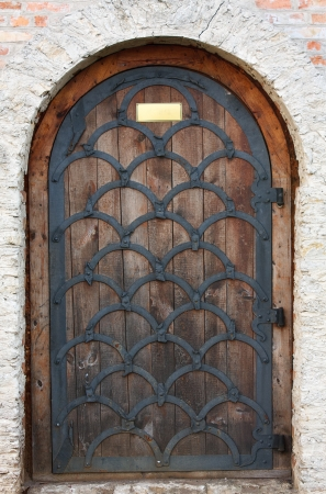 Old wooden door from medieval era  Dubno, Ukraine photo
