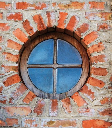 Round window on brick wall on castle  Dubno, Ukraine photo