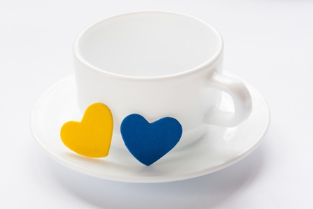empty cup and saucer with hearts on white Stock Photo - 17698355