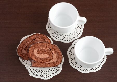chocolate roll on napkins and cup photo