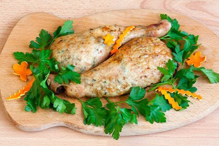 Fried chicken legs with parsley on the board Stock Photo