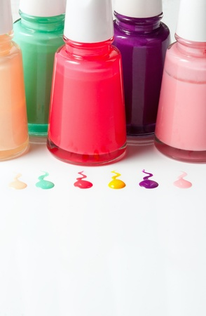 Bottles with spilled nail polish over white background Stock Photo - 18011525