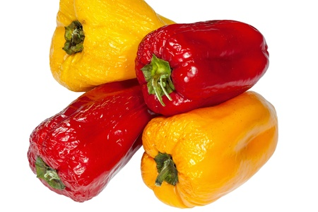 red and yellow old peppers isolated on white background photo