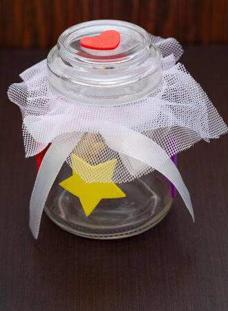 empty jar with a bow on a wooden background Stock Photo - 18225046