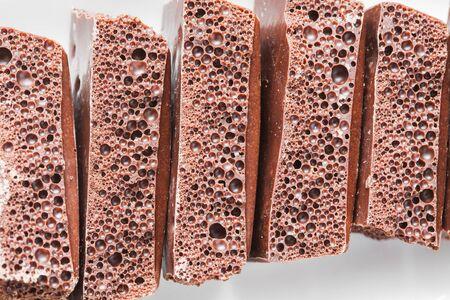 porous: porous chocolate on a plate Stock Photo