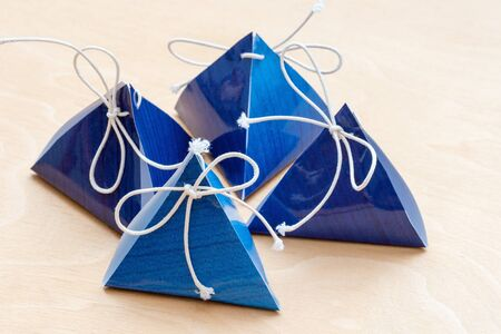 gift bags on a white wooden background