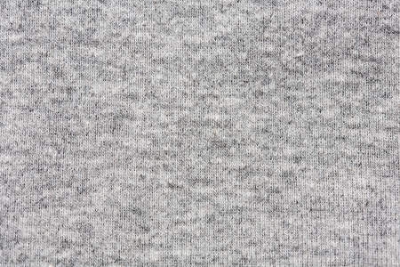 High resolution close up of gray cotton fabric with seams crossing