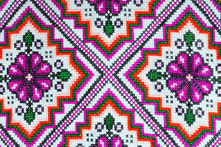 Cross stitch embroidery on canvas. Stock Photo