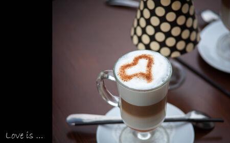 A Latte Coffee art on the wooden desk.