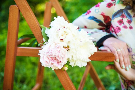 Young happy girl with flowers. white bouquet Stock Photo