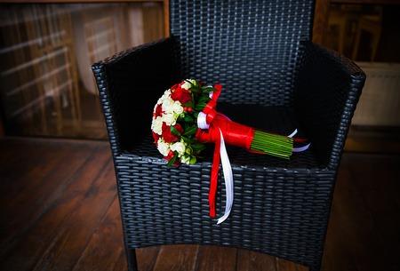beautiful wedding bouquet in a wicker chair