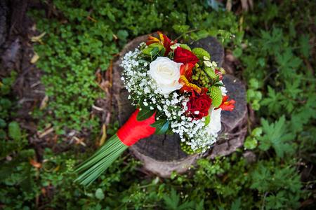 beautiful wedding bouquet lying on green grass