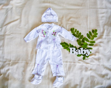 word baby and child clothing with leaf