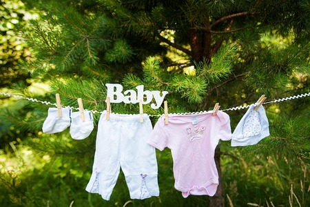 A Baby clothing hanging on the clothesline