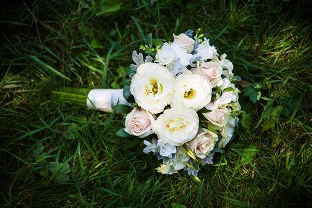 trillium: beautiful wedding flowers bouquet on the green grass