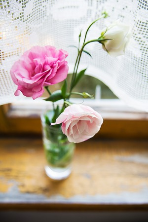 beautiful bouquet of pink and white flowers are on the windowsill