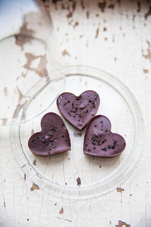 chocolate candy in the shape of a heart on a plate Stock Photo