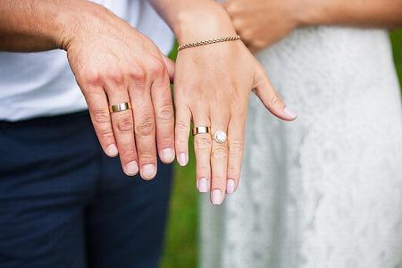 beautiful hands newlyweds display their wedding rings Stock Photo
