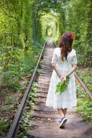 girl holding a fern, tunnel of love