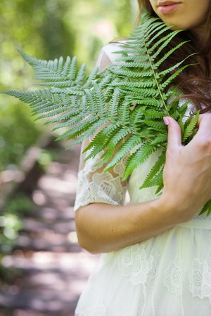 close-up face of a beautiful girl with ferns Stock Photo