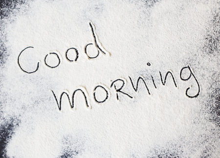 good morning inscription on the board with flour