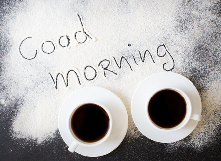 hi back: good morning inscription on the board with flour and two mugs of coffee