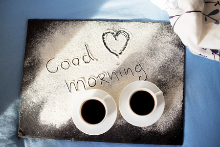 good morning inscription flour on a board with cups of coffee, heart Valentines day Stock Photo