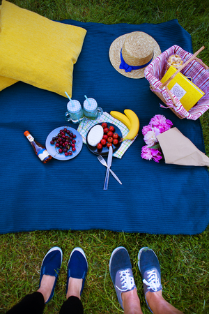 love pic: Bright picnic on the nature-flowers, delicious food, a loving couple Stock Photo