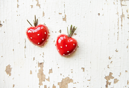 meta: Beautiful and tasty dessert in the form of heart on an old wooden background.