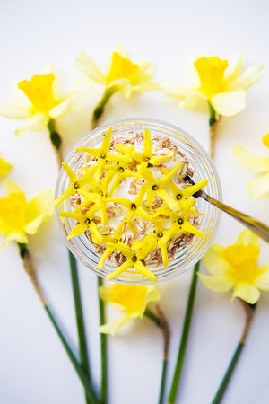 A big bouquet of daffodils and beautiful yellow flowers on the table.