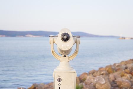 Telescope on the sea-summer, sun, sea beach Stock Photo