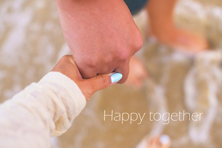 Couple holds on to the sea-happiness forever.