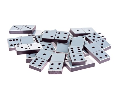 White dominoes lying flat on a white background.