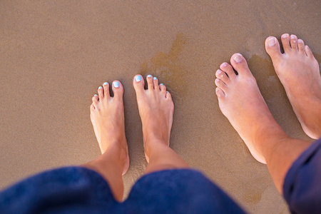 Feet of two lovers on sand-summer, sun, sea, beach