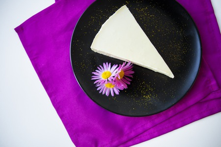 very tasty and beautiful creamy cheesecake decorated with flowers.